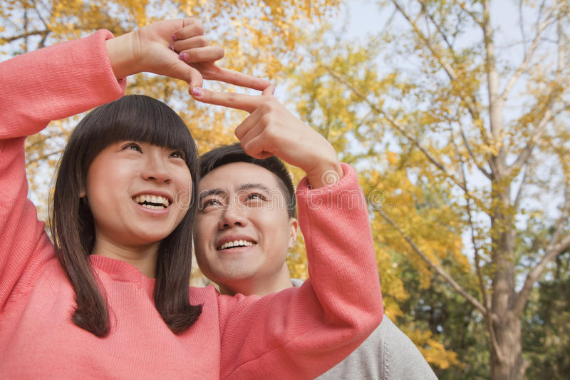 Download Young Couple Framing With Fingers Stock Image - Image: 31694613
