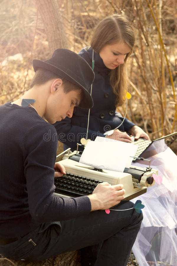 Download Young Couple Freelance Typing On Typewriter Stock Photo - Image of businesswoman, paper: 25268898