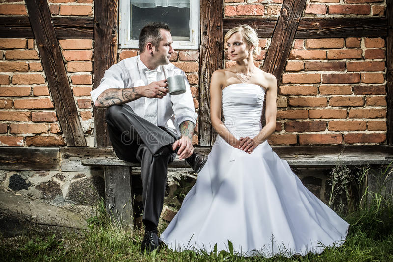 Young couple in front of old vintage house royalty free stock photo