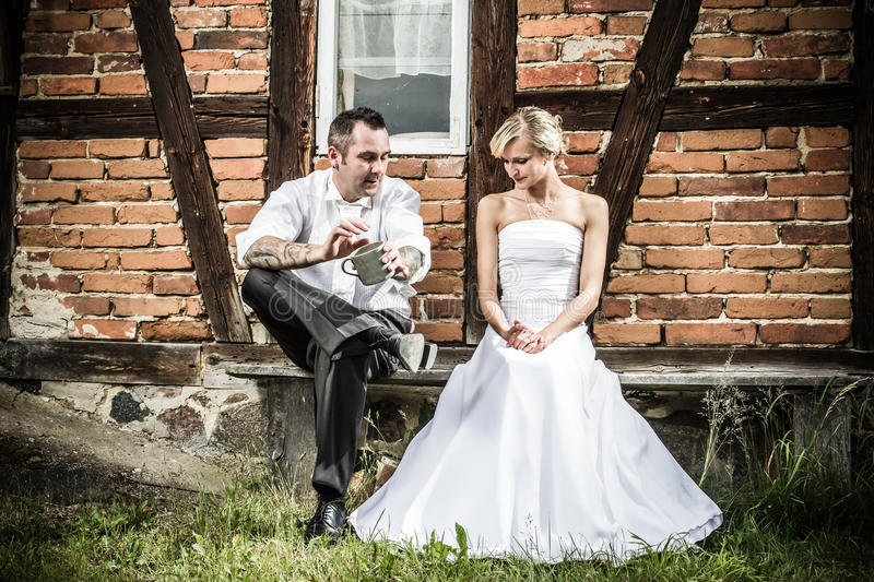 Young couple in front of vintage house royalty free stock photos