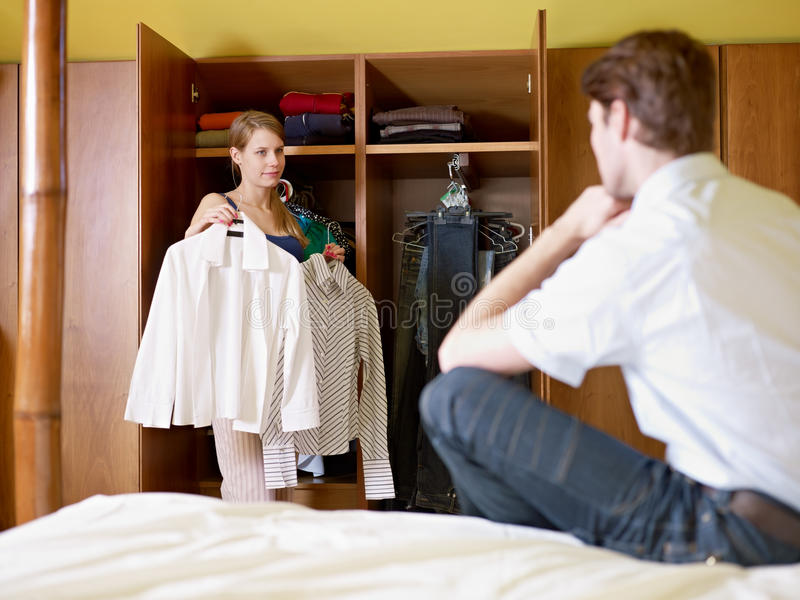 Young couple getting dressed royalty free stock photography