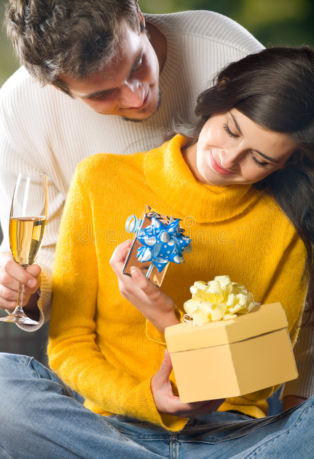 Young couple with gifts royalty free stock photo