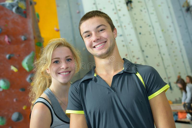 Young couple giving high five in climbing gym royalty free stock images