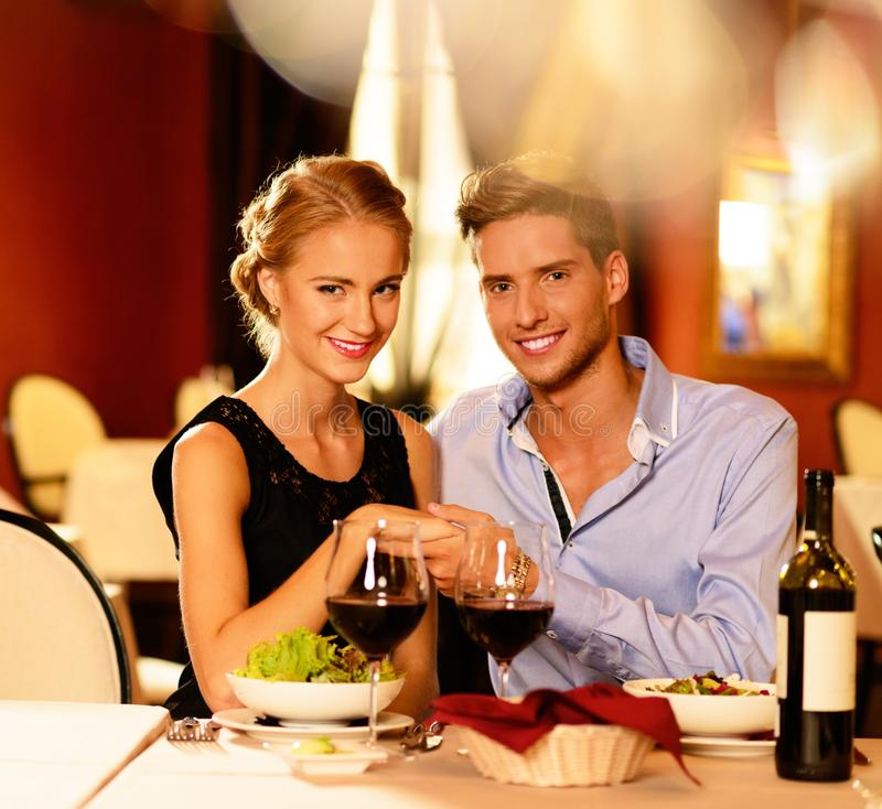 Young Couple With Glasses Of Wine Stock Photo
