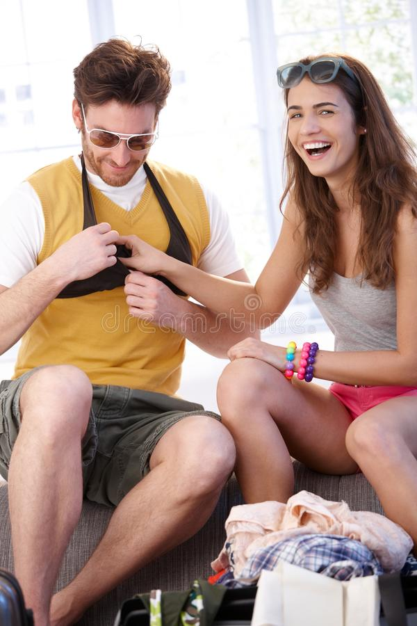 Young couple going to summer vacation packing bag royalty free stock photography