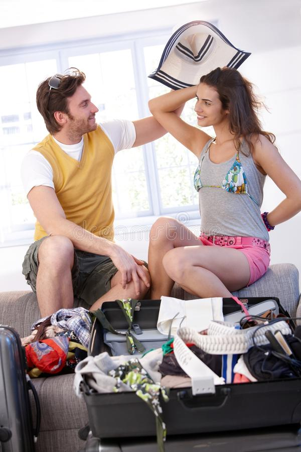Download Young Couple Going To Summer Vacation Packing Bag Stock Image - Image: 19423441
