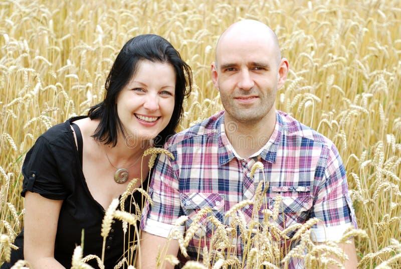 Young couple in a grain field stock photos