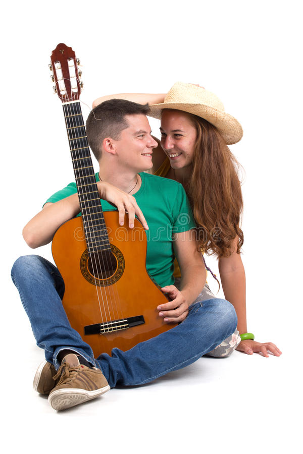 Young couple with guitar stock photography