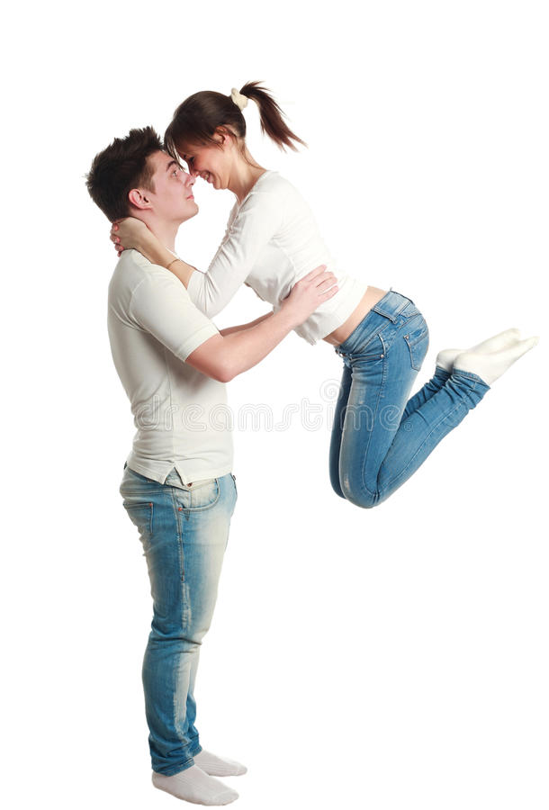 Download Young Couple, Guy With Jumping Up Girl, Studio, Isolated Stock Photo - Image: 30621146