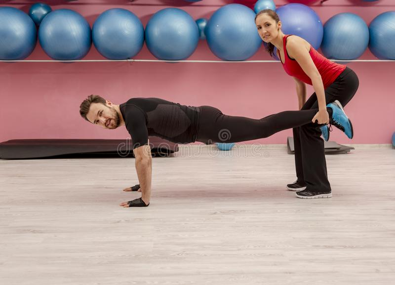 Young couple in a gym royalty free stock photography