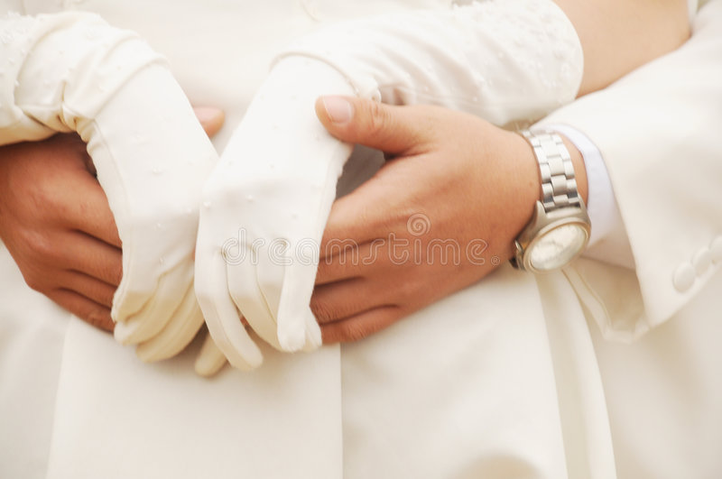 Young couple hand in hand stock photography