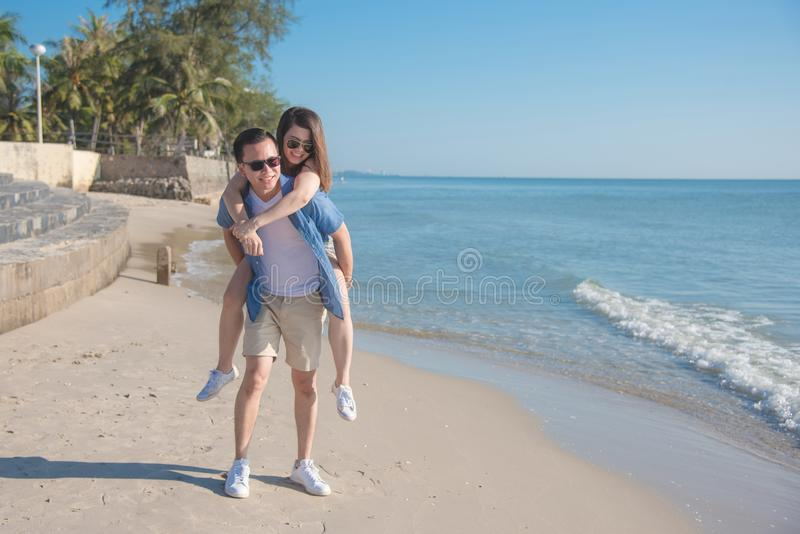 Young couple happy on the beach royalty free stock photos