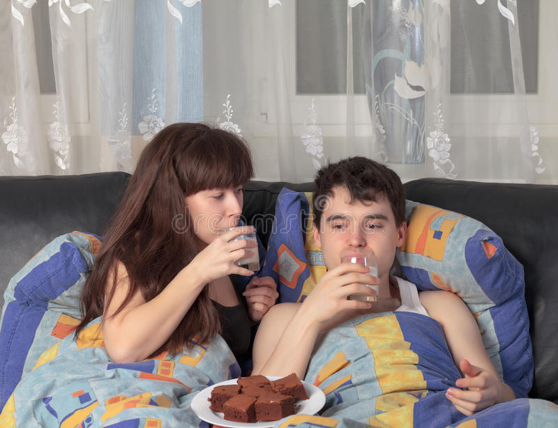 Young couple has breakfast in bed stock photos
