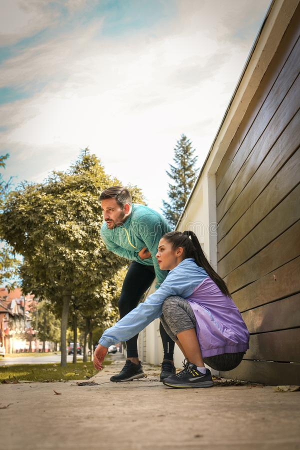 Free Young Couple Have Break After Running. Royalty Free Stock Photography - 105510947