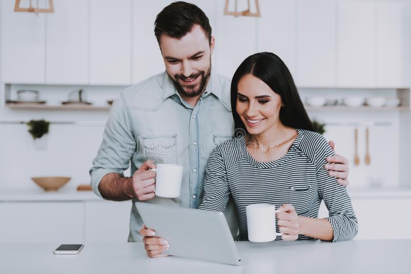 Young Couple Have Breakfast in Morning at Home. White Coffee Cup. Breakfast at Morning. Happy Wife and Husband. Romantic Relationship Concept. Smiling People royalty free stock photos