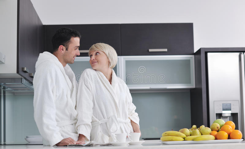 Young couple have fun in modern kitchen stock photography