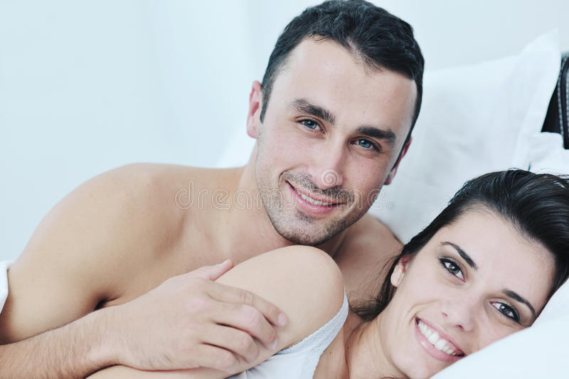 Download Young Couple Have Good Time In Their Bedroom Stock Photo - Image: 22004272