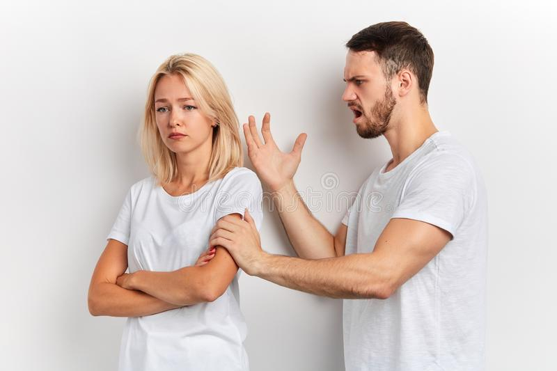 Young couple having an argument, frustrated angry man scolding his wife royalty free stock images