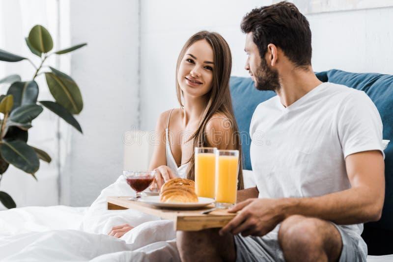 Young couple having breakfast stock photos
