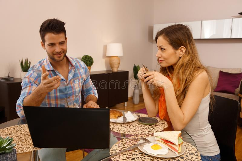 Young couple having breakfast at home stock image