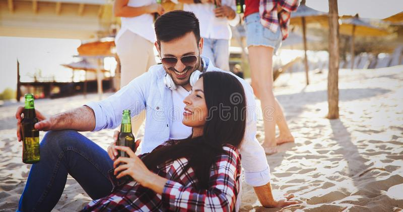 Young couple having fun at the beach royalty free stock photography