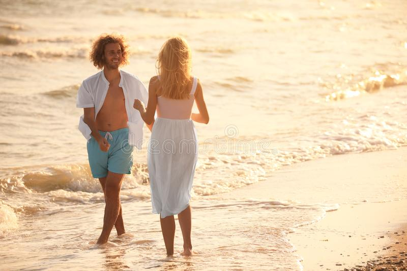 Young couple having fun on beach royalty free stock image