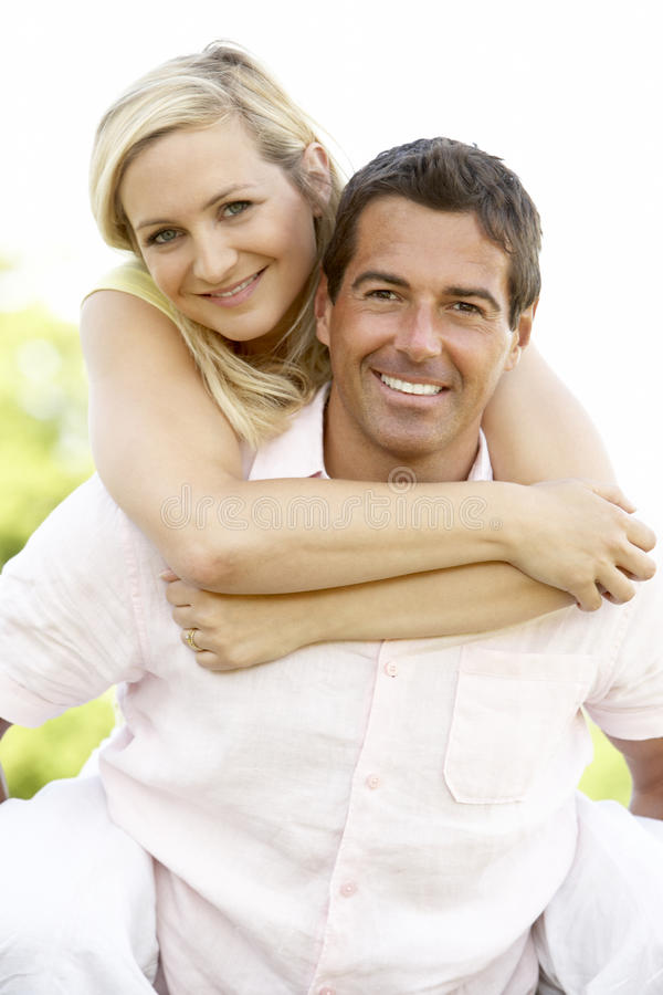Young couple having fun in countryside royalty free stock photo