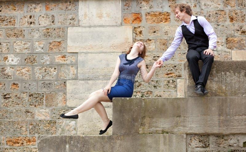 Young Couple Having Fun At The Embankment Royalty Free Stock Photos