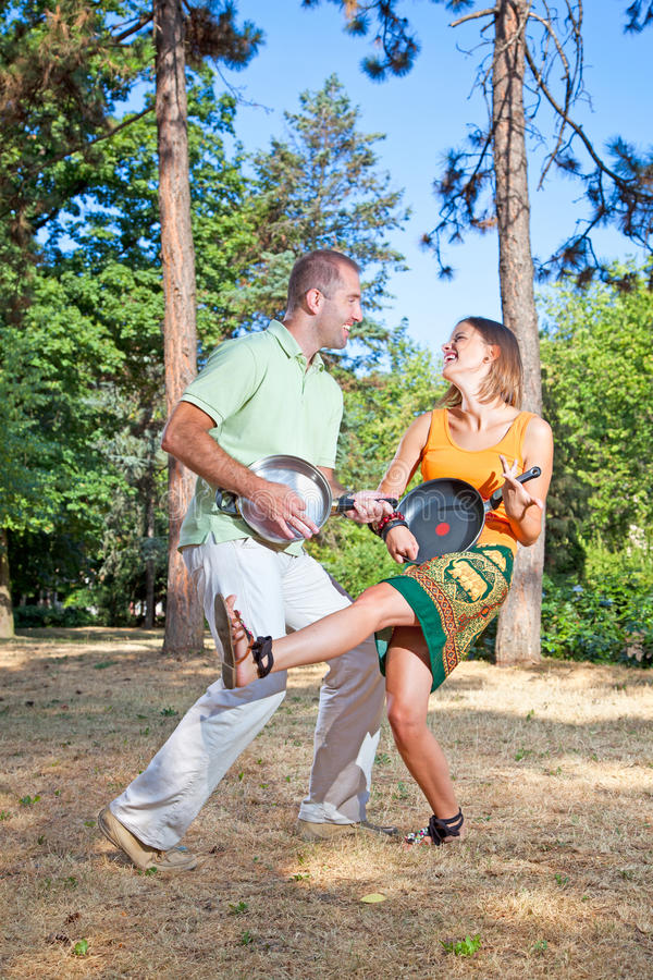 Young couple having a fun in forest stock photo