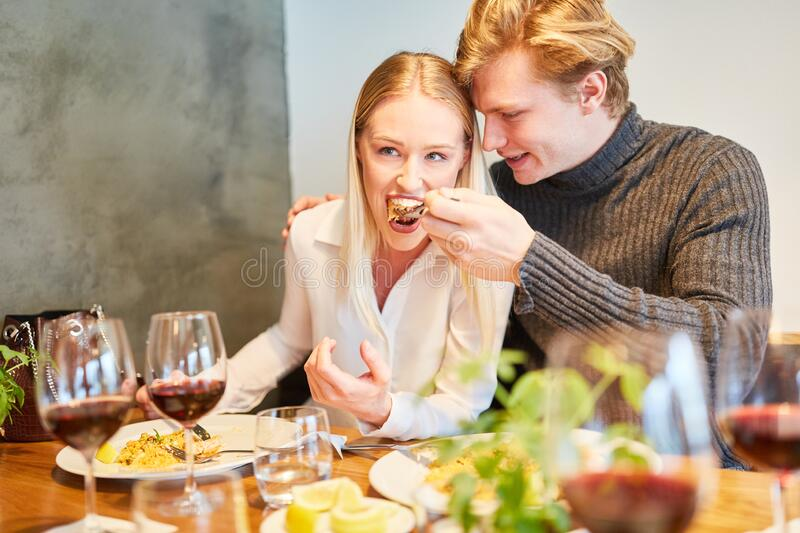 Young couple is having fun at lunch royalty free stock image