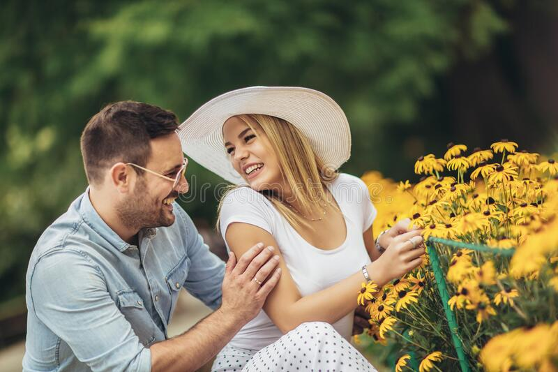 Young couple having fun in the park stock photos