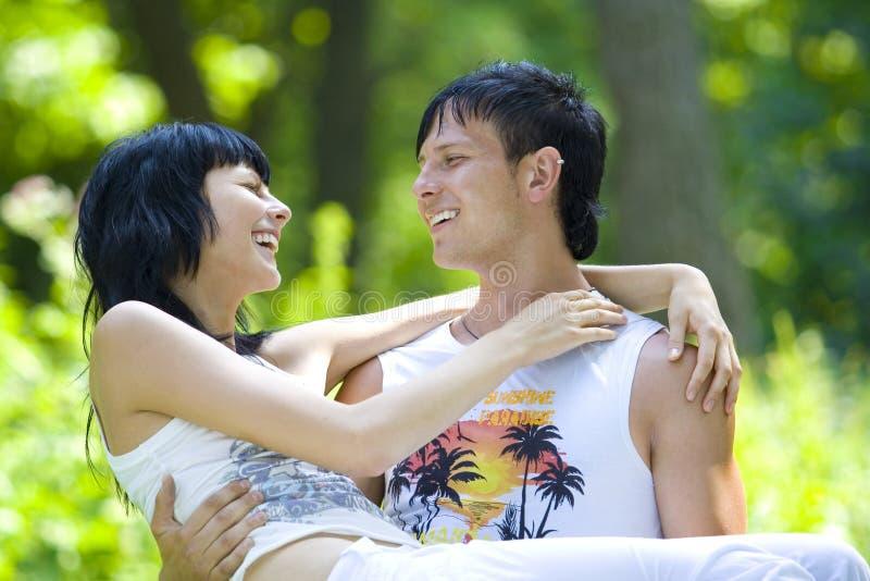 A young couple having fun in the park stock photos
