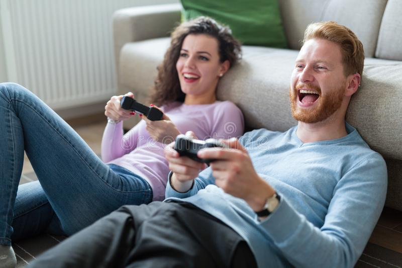 Young couple having fun playing video games. At home stock photos