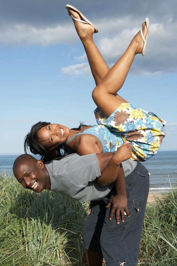 Download Young Couple Having Fun In Sand Dunes Stock Image - Image: 13672889