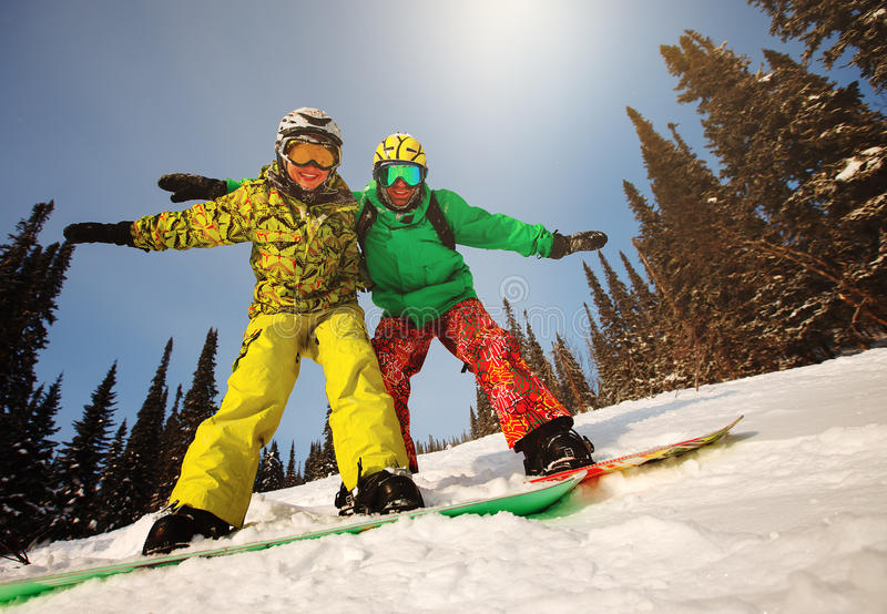 Young couple having fun with snowboards. royalty free stock photo