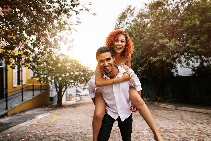 Young couple having fun in the street on a sunny day. royalty free stock photo