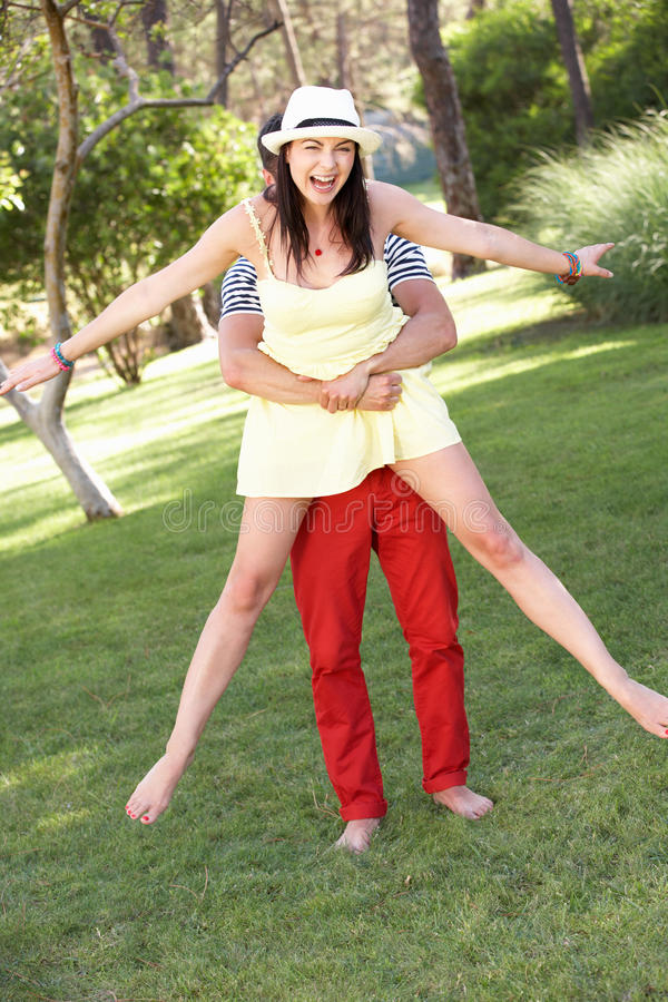 Young Couple Having Fun Together In Garden Stock Image