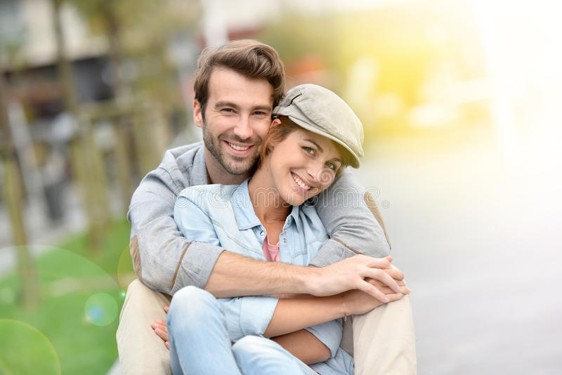 Young couple having fun in town stock photography