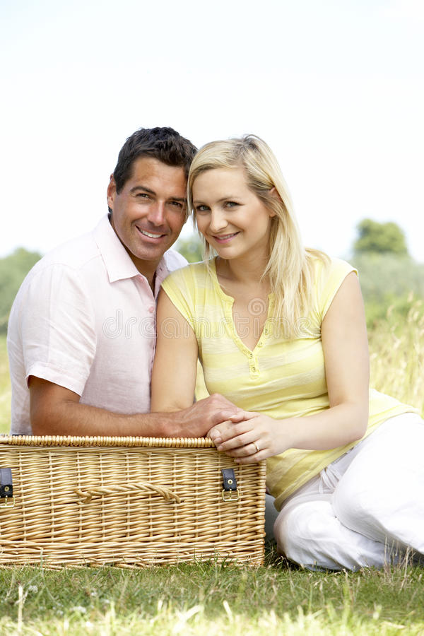 Young couple having picnic in countryside stock photography
