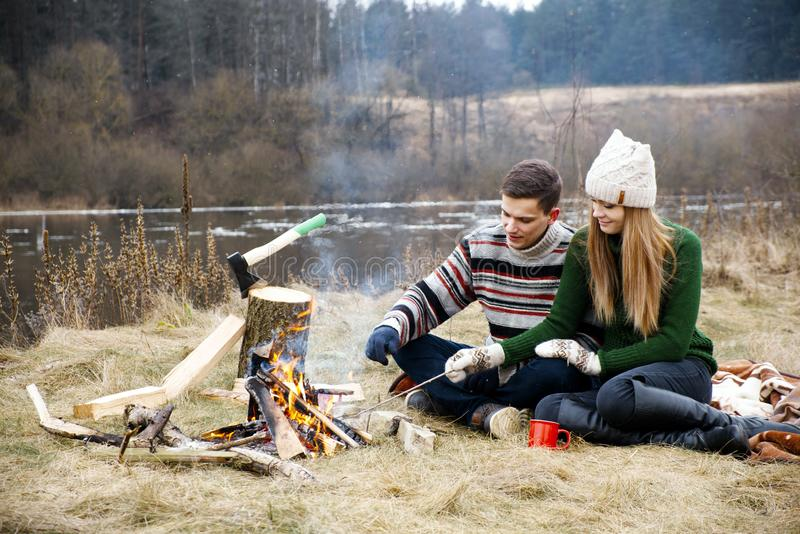 Young couple having a picnic. Happy couple in love sitting and enjoying on the park together. royalty free stock images