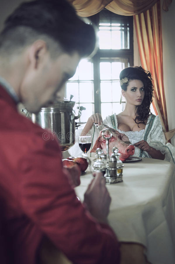 Young couple having strange breakfast royalty free stock photography