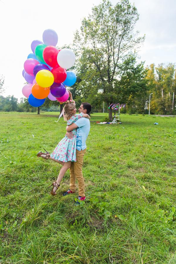Young couple having weekend and walking with balloons on nature royalty free stock photo