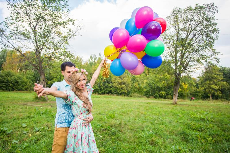 Young couple having weekend and walking with balloons on nature royalty free stock photos