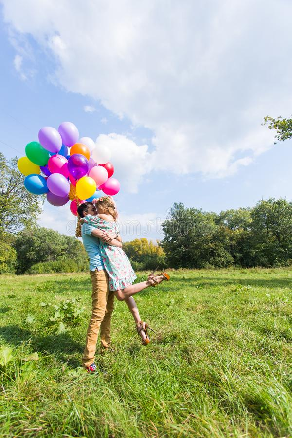 Young couple having weekend and walking with balloons on nature stock photos