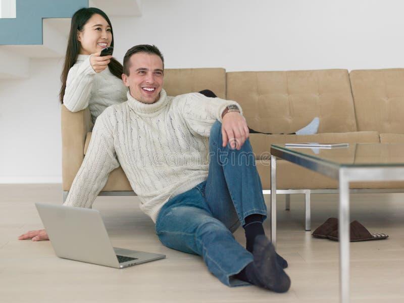 Young multi etnic couple having wonderful time stock image