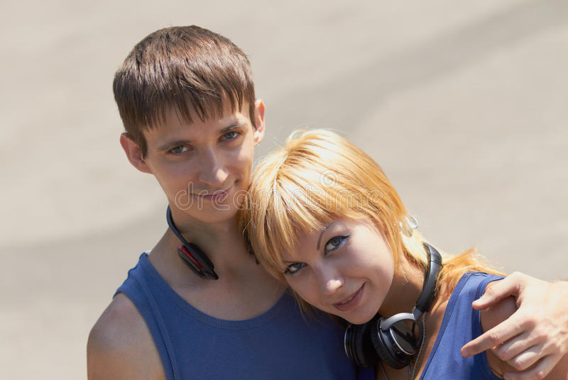 Young couple with headphones posing royalty free stock image