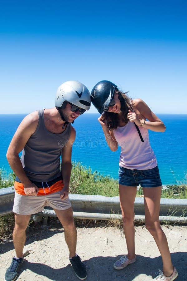 Young couple helmet fighting stock photography