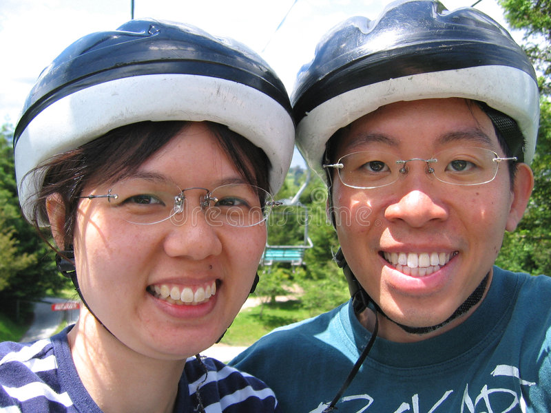 Download Young couple with helmets stock photo. Image of glasses - 42972