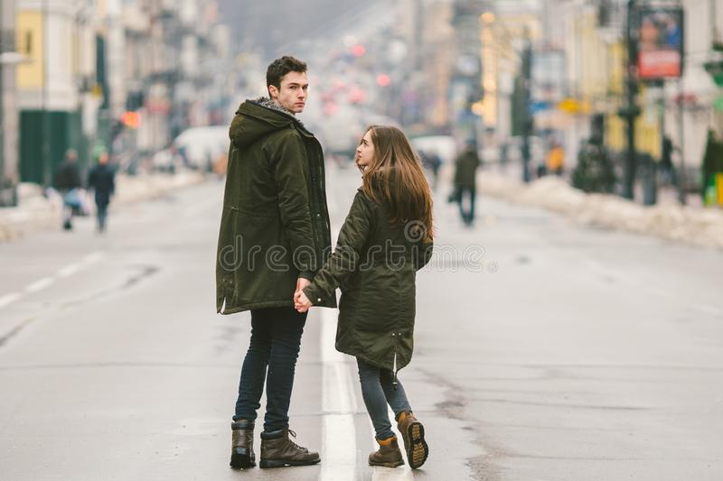 Young couple, heterosexual boy and girl of Caucasian nationality, loving couple, walk around the center of country of European. City in the middle of road on stock photos