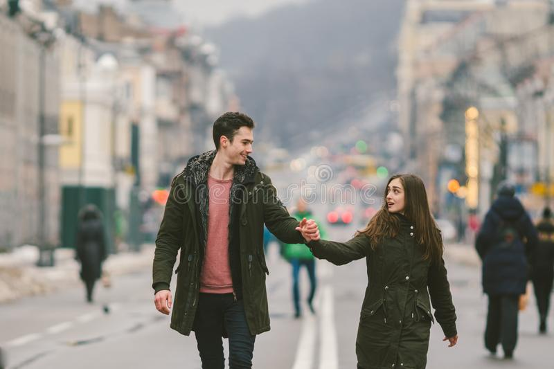 Young couple, heterosexual boy and girl of Caucasian nationality, loving couple, walk around the center of country of European. City in the middle of road on royalty free stock images